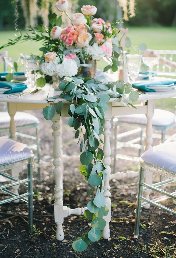 eucalyptus table runner - photo by Sarah McKenzie Photography http://ruffledblog.com/soft-pastel-waterside-wedding