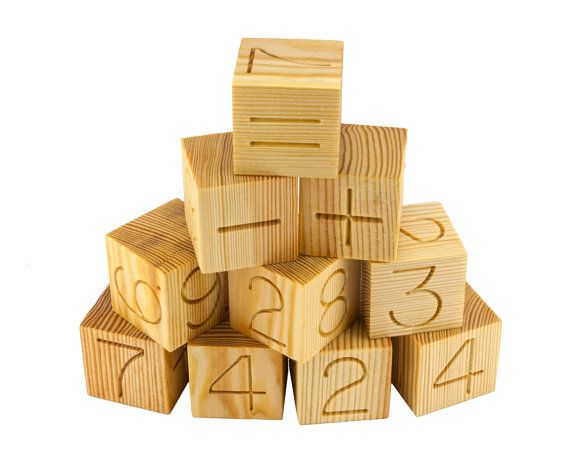 This set of 12 natural handmade wooden toy Math Blocks includes numbered wooden blocks from 0 to 9 and equation (plus, minus, equal) engraved on two sides of each block. Number blocks are great for children learning to count and learning the basics of Math. Smooth surface. The blocks are made of pine, treated with natural linseed oil. Packed in a linen bag.   www.etsy.com/shop/KlikKlakBlocks