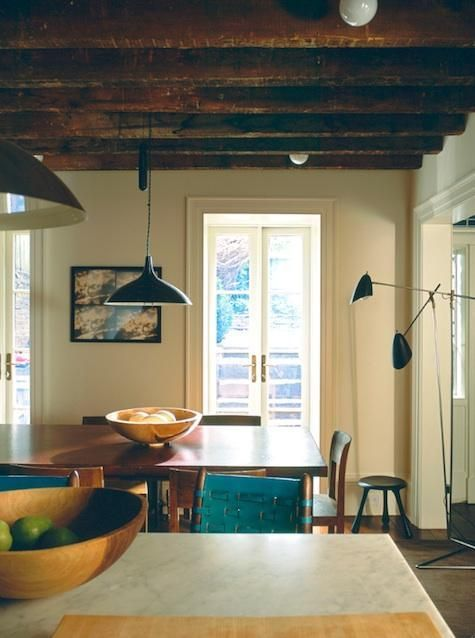 Kitchen interior from the actress Julianne Moore´s West Village townhouse, New York: Paavo Tynell counter balance pendant light, manufactured by Taito Oy, Finland, ca.1950s. / Remodelista