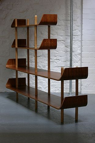Plywood Bookcase by Wilhelm Lutjens. Like how the bent ends will keep items from falling off, as well as giving it a nice style detail.