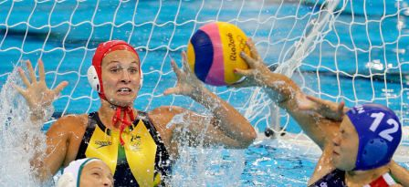 Goalkeeper Lea Yanitsas #1 of Australia defends as Krisztina Garda #12 of Hungary takes a shot on goal during their Women's Water Polo quarterfinal match against Australia at the Rio 2016 Olympic Games on August 16, 2016 in Rio de Janeiro, Brazil. © 2016 Getty Images