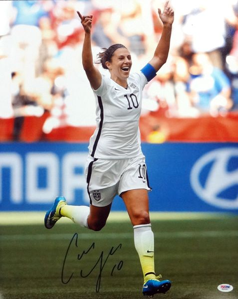 "This is a 16x20 photo that has been hand signed by Carli Lloyd. It has been authenticated by PSA/DNA. It comes with their """"In The Presence"""" sticker and matching certificate of authenticity. This wil"