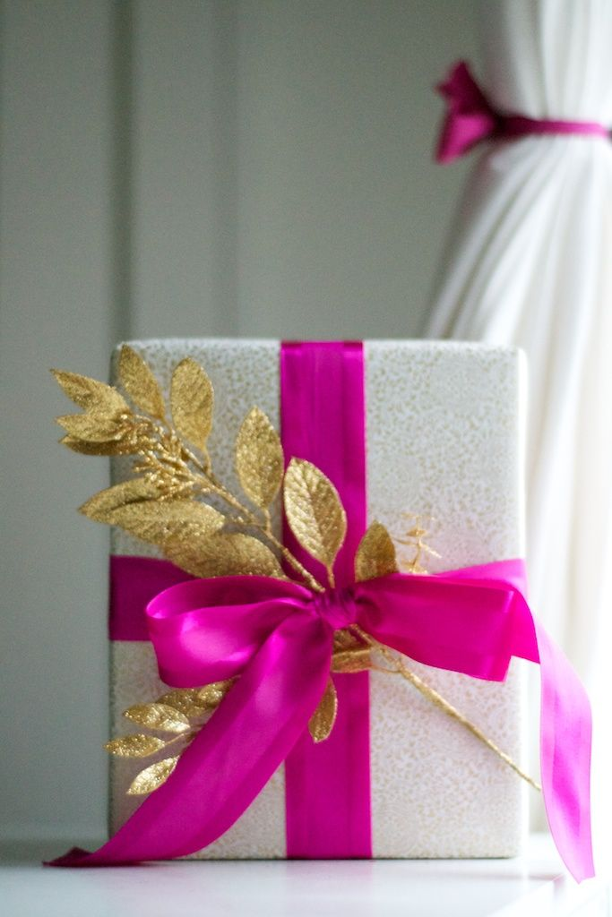 Silver glitter wrapping paper, and a bright fuchsia bow.