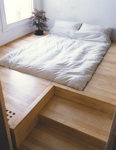 This Japanese Bed by Oliver Peake was a commission for a client who wanted a sunken bed and hidden storage. The floor was raised to make space for the storage below and to give the bed a platform. via Apartment Therapy - I like this but not so sure how easy it is to make bed in the morning...