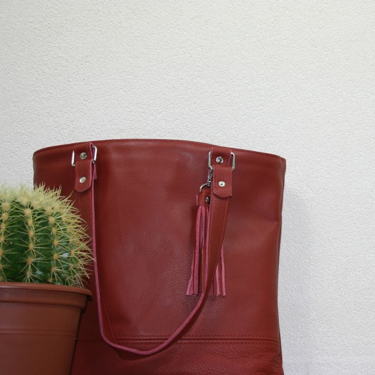 An old leather couch is remade into a leather bag. Go to upcycled.nl for all the upcycled bags! (worldwide shipping)