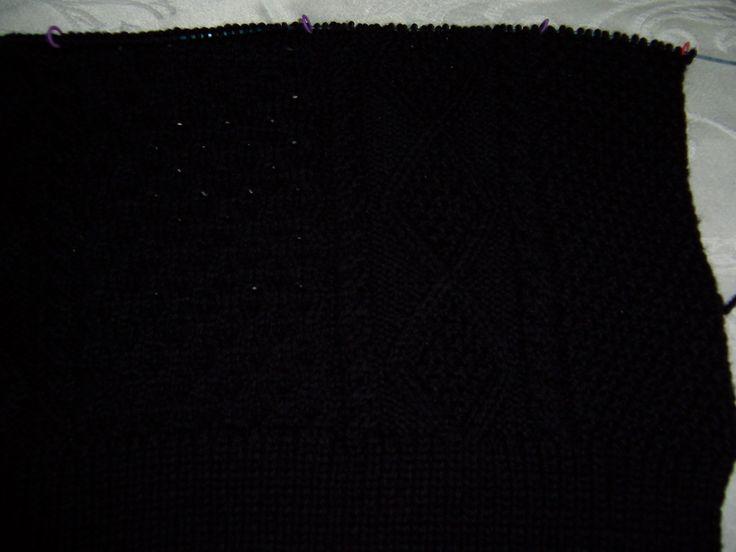 Back of Aran knit cardigan in Knit Picks Swish yarn.