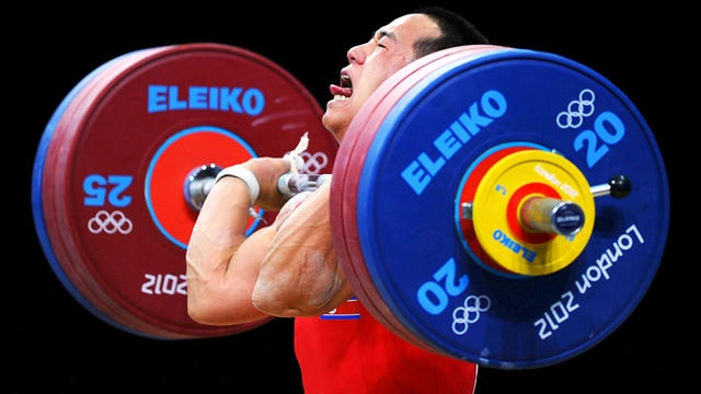 Yun Chol Om of North Korea breaks the Olympic Record in the Mens 56kg clean and jerk weightlifting on Day 2 of the London 2012 Olympic Games.