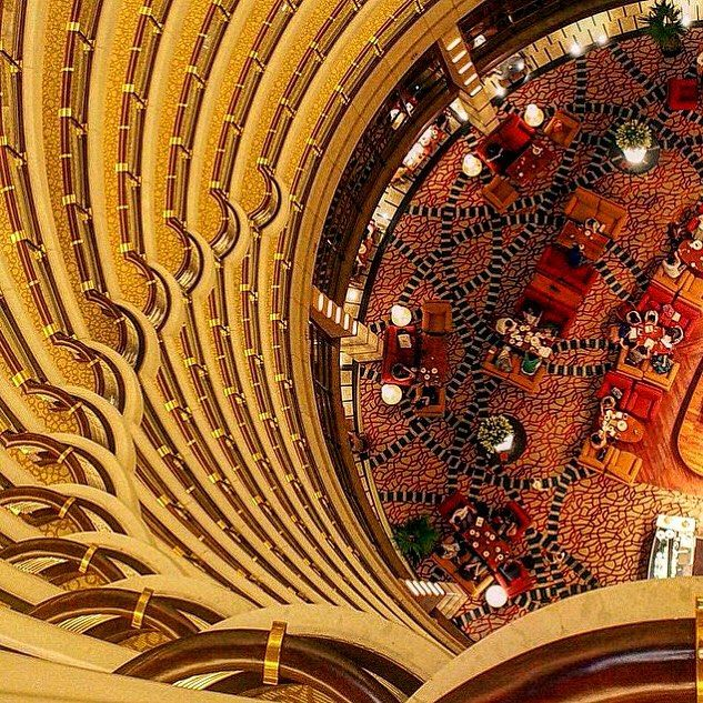 Golden light cascades from the Pagoda-inspired architecture to illuminate the 54th floor lobby at Grand Hyatt Shanghai.