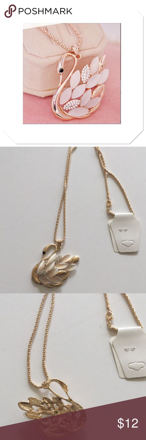 """Beautiful Swan Necklace Beautiful fashion jewelry, this swan has pearl and crystal feathers, goldtone alloy, pendant is approx 2"""" x 2"""" on a 28"""" chain Boutique Jewelry Necklaces"""
