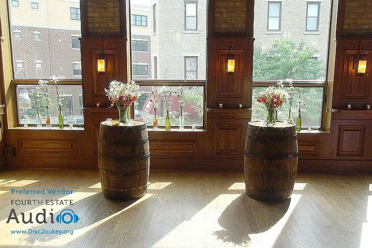Two beer barrels and some flowers and bottles created a wonderful homespun altar. http://www.discjockey.org/real-chicago-wedding-august-14-2016/