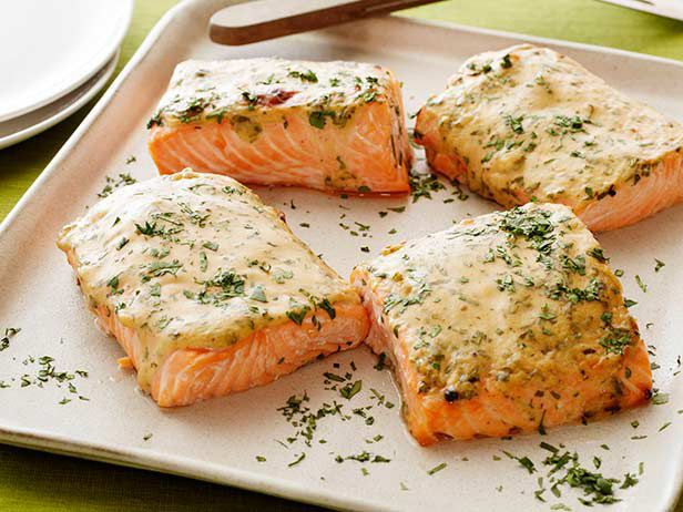 Maple-Mustard Roasted Salmon : Made with just five ingredients (plus salt and pepper), this salmon recipe is primed for weeknight cooking. Just spread the mustard-maple sauce over each fillet, and then bake until the fish is cooked through. The dish will be ready in just 20 minutes. via Food Network
