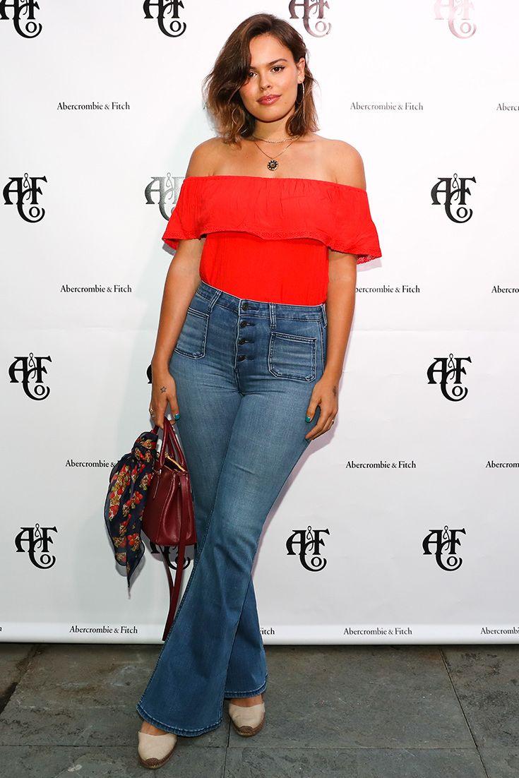 Atlanta de Cadenet wearing a red off the shoulder crop top with jeans in LA.