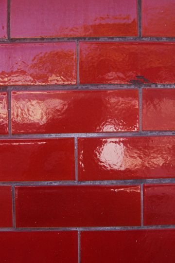 Glazed brick wall.
