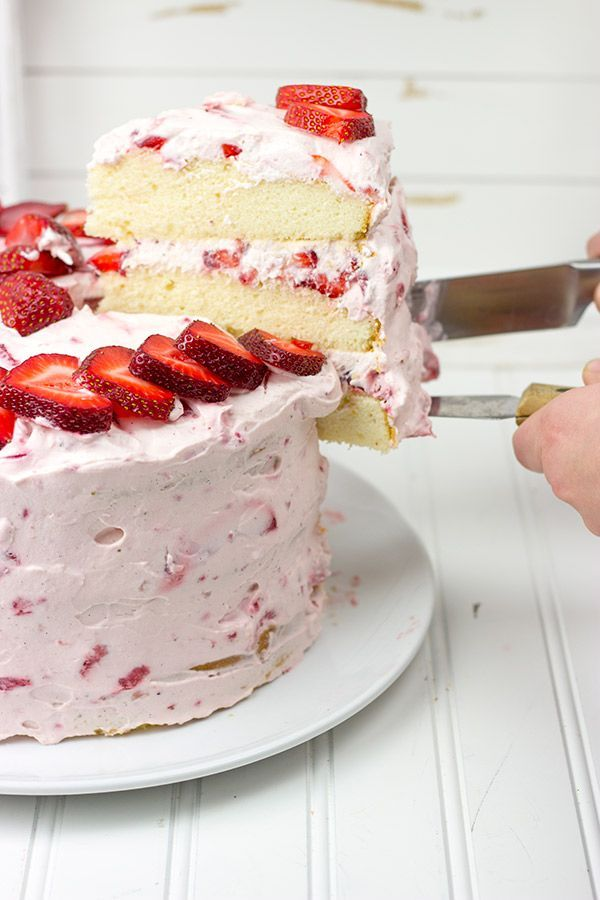 This Fresh Strawberry Cake features loads of ripe berries and a light whipped cream frosting...making it the perfect summer dessert!