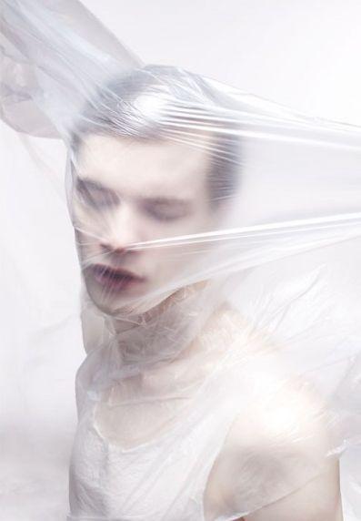 Artyom Shabalov by Dorothée Murail - cling film to distort the body | plastic | milk | fashion editorial