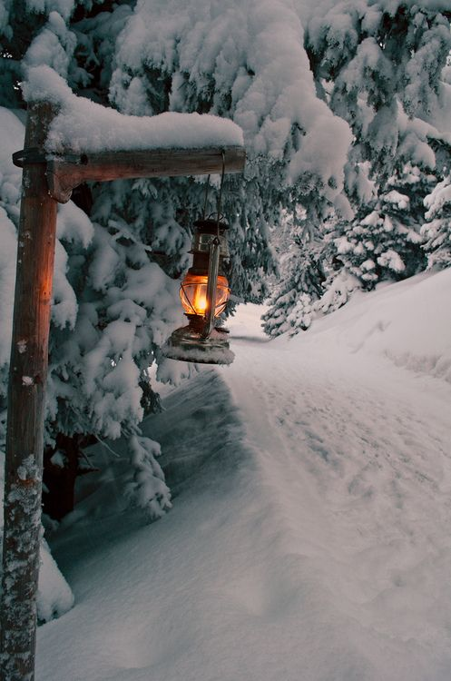 Finding inspiration from the Alps, Switzerland. Love the serene whites and cozy lantern.
