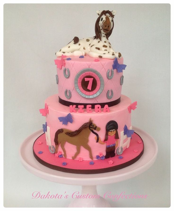 Horse Birthday Cake - The birthday girl provided me with a sketch for what she wanted her cake to look like and I tried to bring her vision to life.  The cake is frosted in buttercream with fondant accents.  The horse on top is fondant and made to resemble her favorite horse.