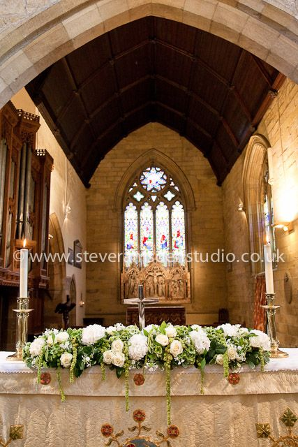 Altar wedding flowers at St Marys Church Masham by Susie Hart