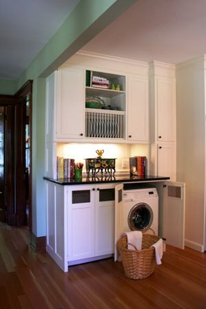 Hidden Washer and Dryer in a family room or other open space.