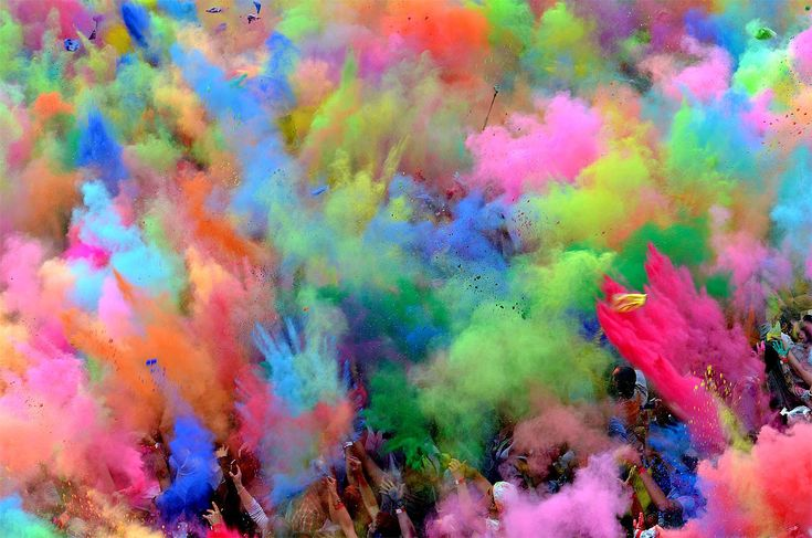People throw colored powder into the air during the Holi Festival in Berlin. The original Holi, also known as the festival of colors, is a festival celebrated in India and other Hindu countries. Some thousands of people celebrated this event with Indian Djs, acrobatics and dance in the German capital. (Oliver Lang/dapd)