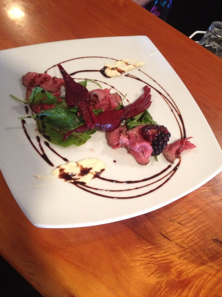 Beef carpaccio, beets, blackberry and balsamic, with horseradish cream.