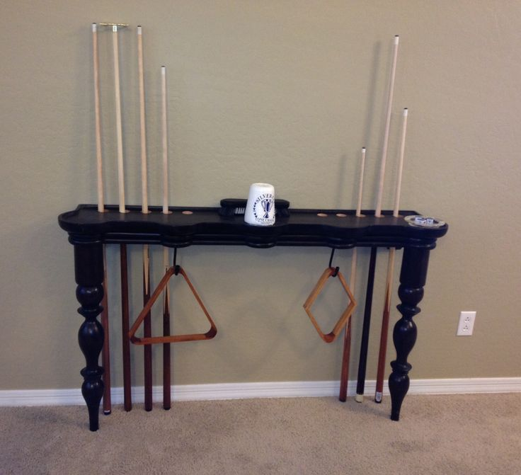 Pool cue stick holder made from modified sofa table.