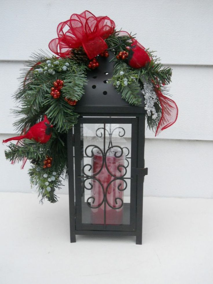 Winter floral pine greenery arrangement candle lantern