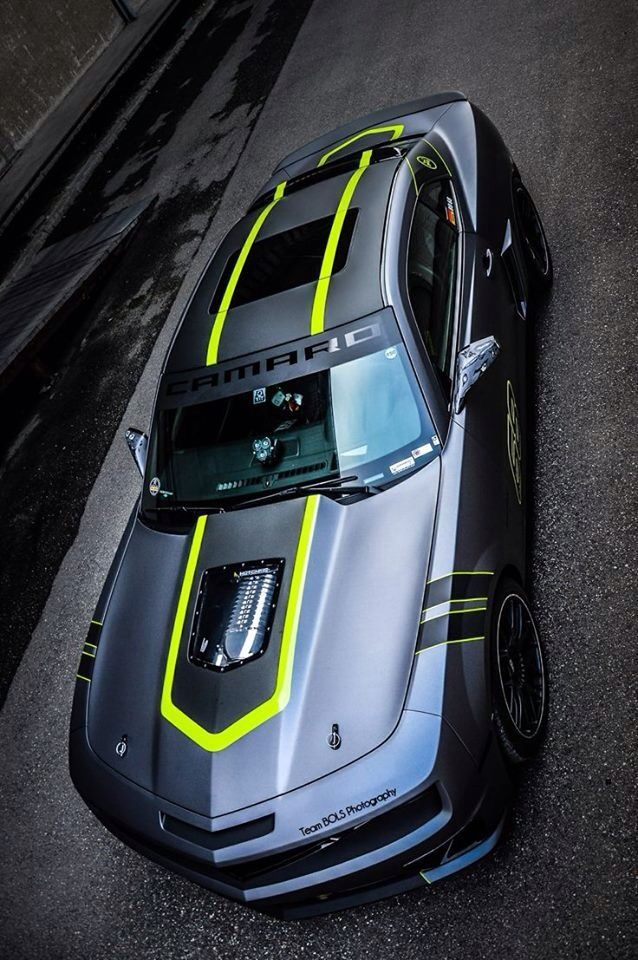 black car with flat black stripes and bright green accents ...