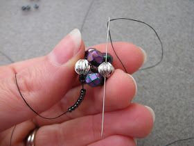 I made these earrings earlier this month as part of the OTTBS earring challenge. I was just playing about embellishing right-angle-weave...