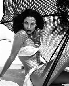 JLo. Black and white Jennifer Lopez photography in white two peice swimsuit. Old hollywood glamourous style