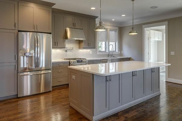 Medium gray cabinets with white countertop and dark floor for Grey and white kitchen cabinets