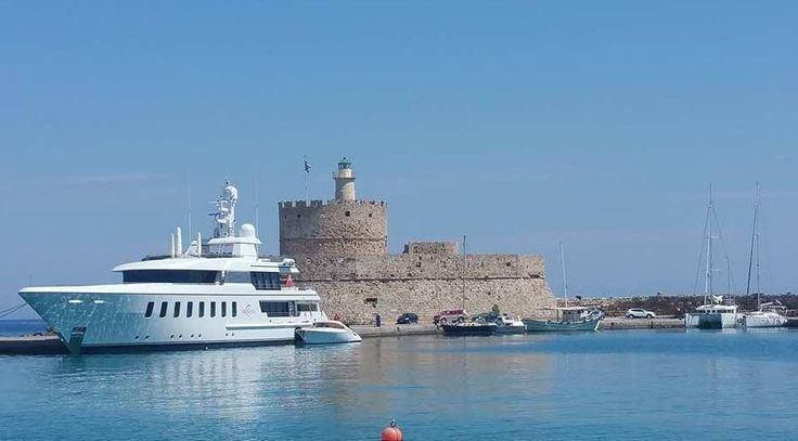The Fortress Of St Nicholas standing guard at the Madraki Port Entrance - Rhodes Greece  https://theislandofrhodes.com/rhodes-town-in-greece