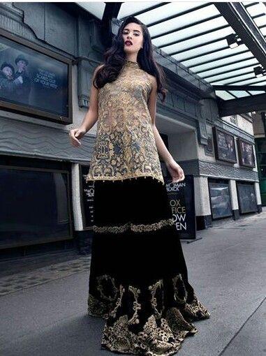 Pakistani high fashion. Black gharara, beige kameez. Designer: Saira Rizwan.