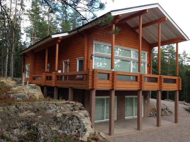 Milla 195 - г. Puumala  /Уютный домик на границе леса. Комфорт, красота природы и чистый воздух. Что ещё нужно для отдыха от повседневных забот?/ Элитный дом в г. Пуумала на склоне, вписанный в традиционный финский ландшафт валунов и отлогов, имеет множество замечательных особенностей — два с половиной этажа, торцевое панорамное окно, удобные подсобные помещения, обширный балкон и террасу. В доме шесть комнат и холл, три санузла, три душевые и сауна.