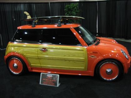 Orange Mini Cooper thing ! , wonder what this stupid thing will cost .