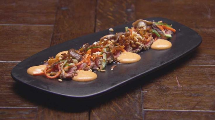 Sesame Beef Tataki with Gochujang Aioli, Pickled Vegetables, Puffed Rice and Carrot Chips
