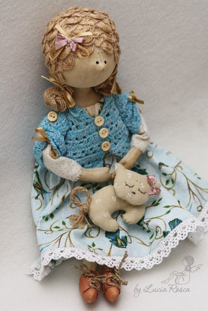 Really like the little crochet jacket, doll by Lucia Rosca.