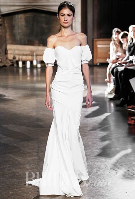 Brides.com: . Style BR-15-21, off-the-shoulder puff sleeve crepe sheath wedding dress with a sweetheart neckline, Inbal Dror