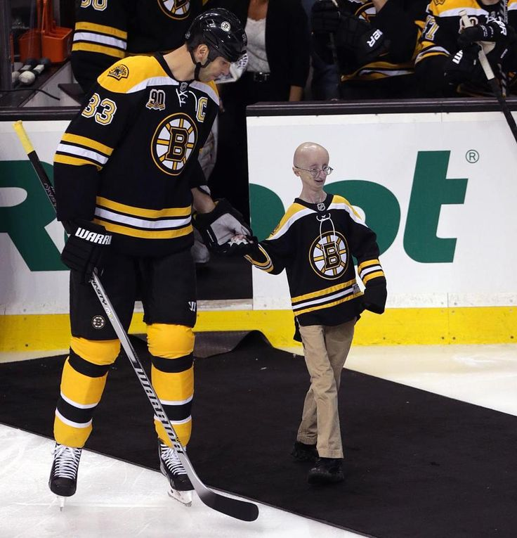 "Bruins defenseman Zdeno Chara escorted Sam Berns, the subject of the documentary film, ""Life According To Sam,"" to drop the puck at TD Garden during Progeria Awareness Night.  PRF volunteers helped raise a record $32,000 for the 50/50 Raffle, and fans in the stands contributed to PRF by texting PROGERIA to 80888 to donate $10!"
