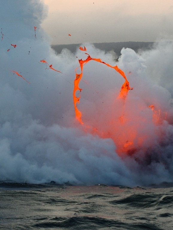 Kilauea volcano lava flow spitting into the air and ocean