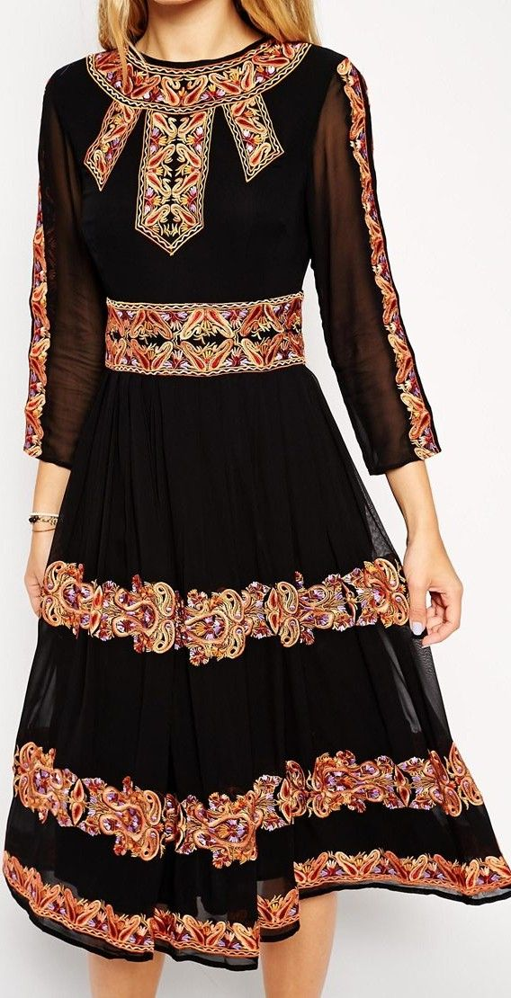 This looks like a print dress with Russian or Ukrainian or Slavakian embroidery pattern... even though it's a print. I could be wrong. Anyway, it's a folk inspired dress - http://www.boomerinas.com/2014/10/03/folk-inspired-clothing-modern-folklore-fashions-fall-2014/