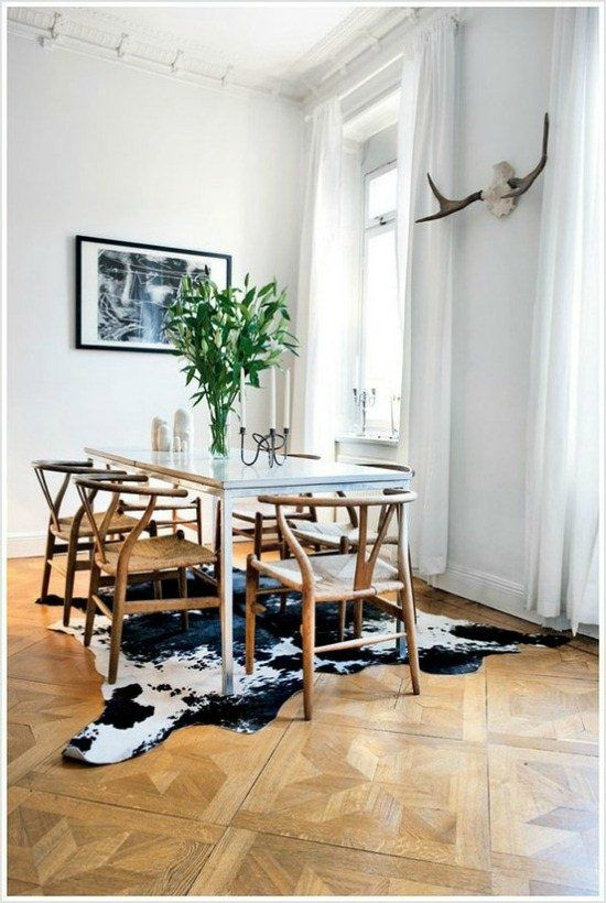 Cow Hide Rug in an Eclectic Dining Room