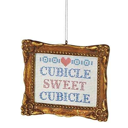 Hang a baby framed ornament to get that homey vibe.