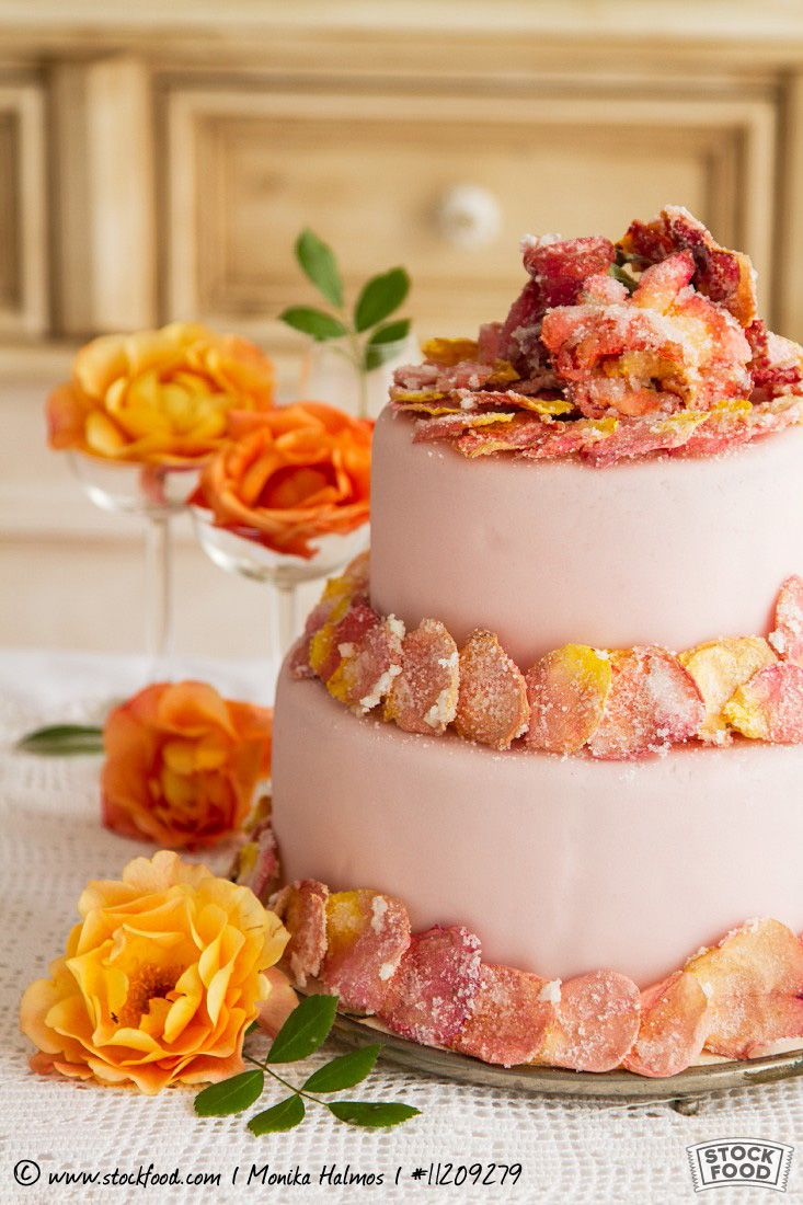 Two-tier layer cake with candied rose petals
