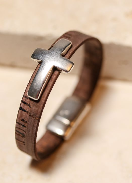 First Communion Gifts - Soft dark charcoal bamboo leather closes around your wrist with a magnetic clasp and showcases a stainless steel cross. A handsome piece that can be worn by either gender. The bold cross is a simple reminder of our ever present teacher sent to guide us in the name of Jesus.