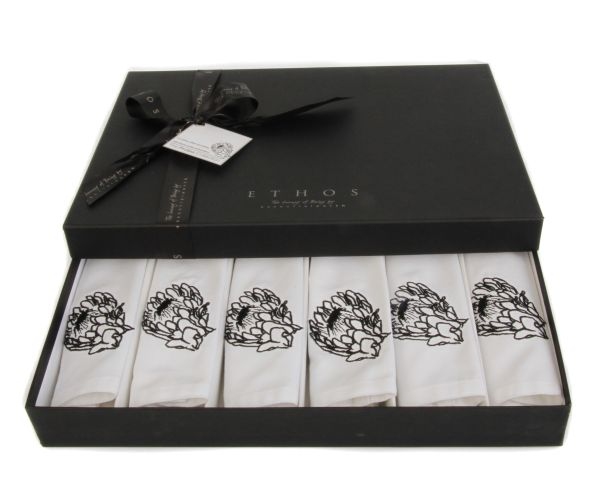 Protea Napkin set of 6 - each luxurious napkin is made from 100% white cotton with an embroidered black protea detail. #protea #serviette #cotton #napkin