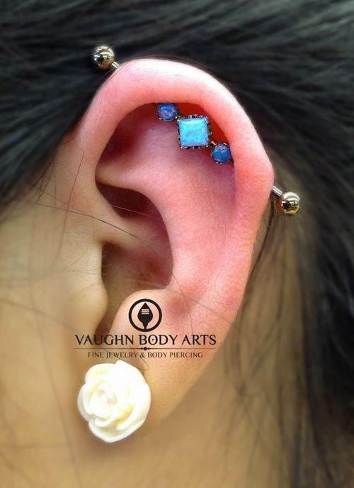 A fresh industrial piercing done on our wonderful client Jazmine. Anatometal 14g implant grade titanium barbell that we anodized into a ligh...