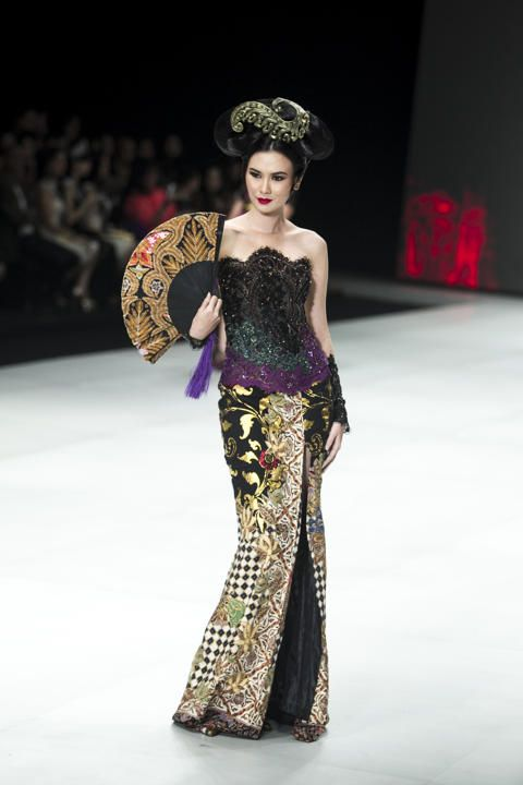 A model showcases designs by Anne Avantie on the runway during Indonesia Fashion Week 2014