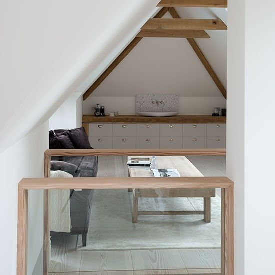 White attic living room with alcove storage