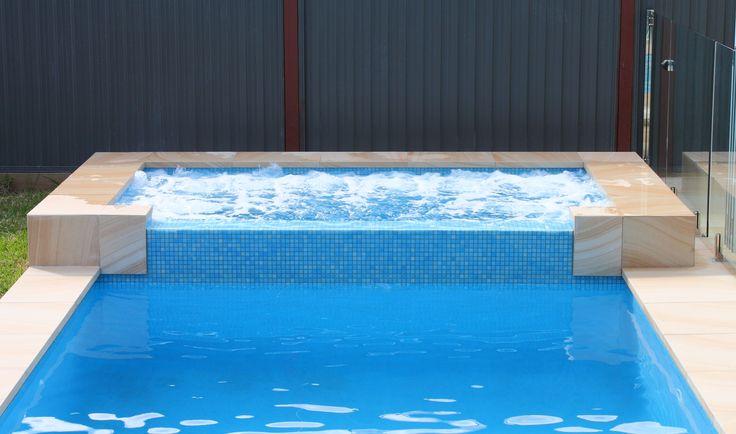 Amber Tiles Kellyville: Pool by Malibu Pools. Urban Surface. Mediterranean pool mosaic. #urbansurface #poolinspiration #ambertiles #poolmosaic